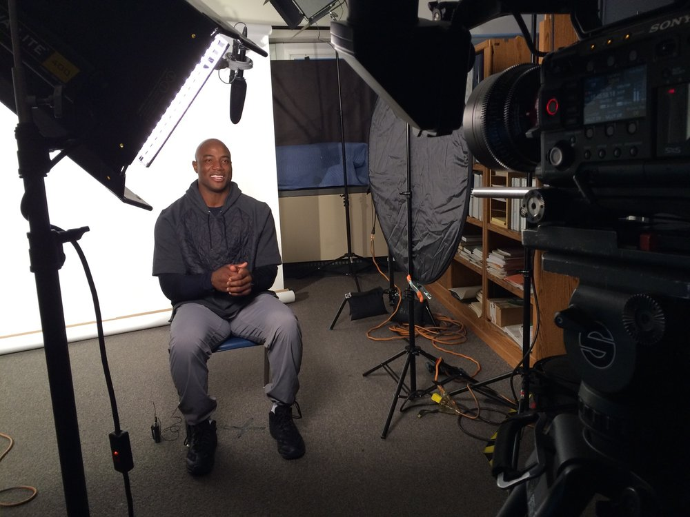 DeMarcus Ware interview in front of white seamless