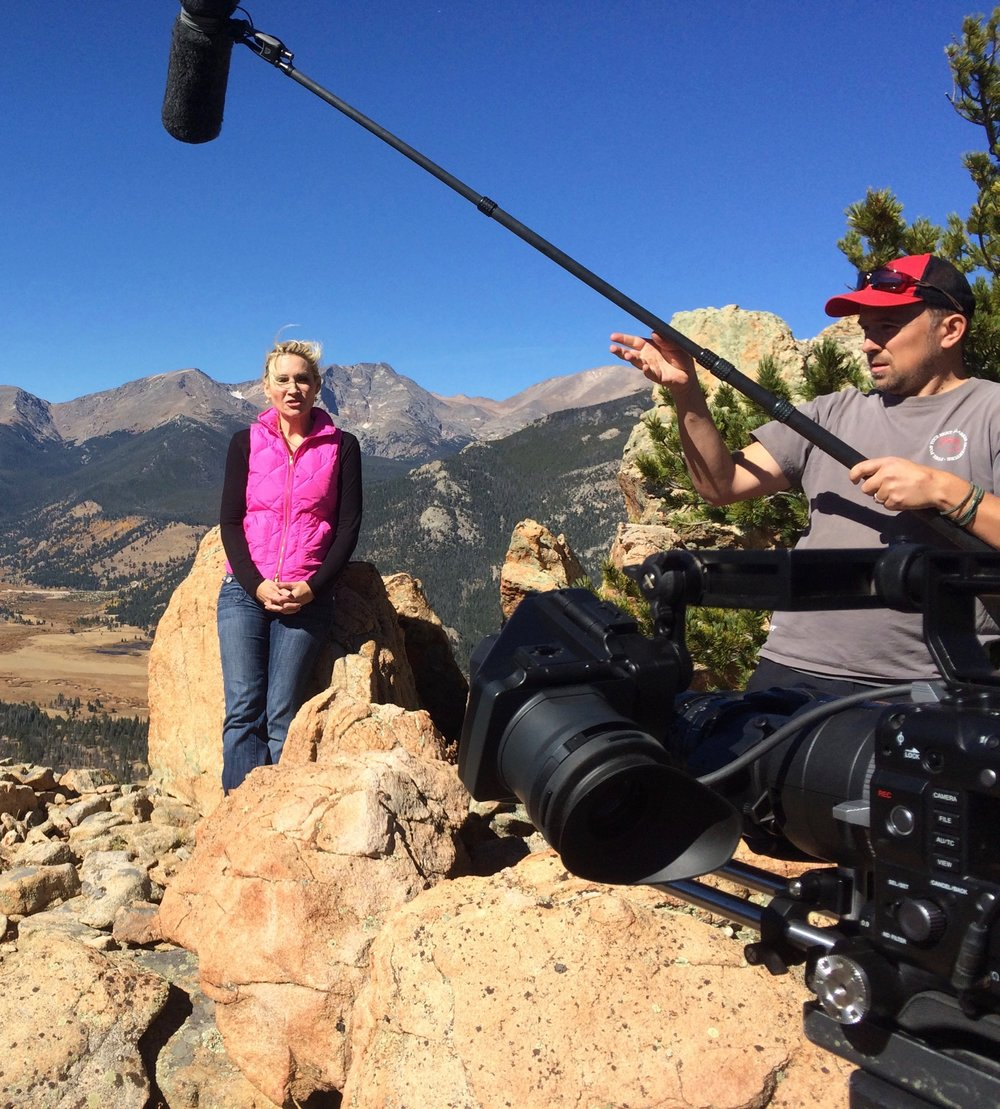 Filming Andrea Canning Stand-ups on cliff