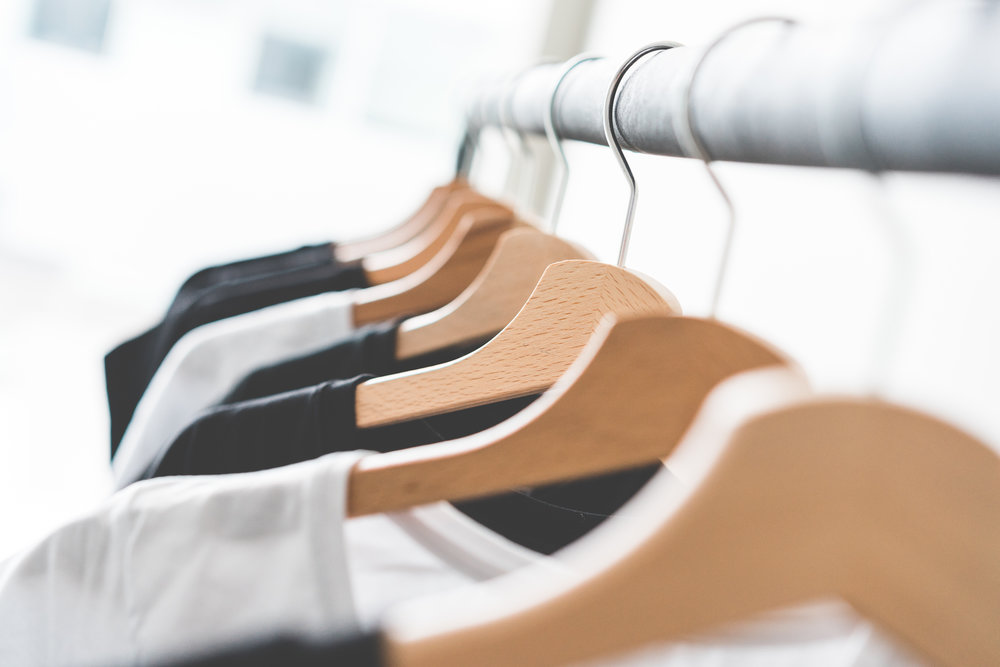 wooden-t-shirt-hangers-in-fashion-apparel-store-2-picjumbo-com.jpg