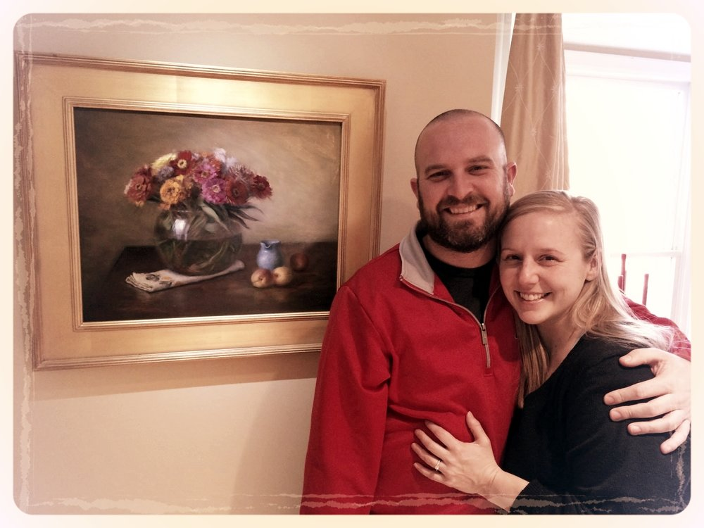 Happy couple with a custom Thimgan painting