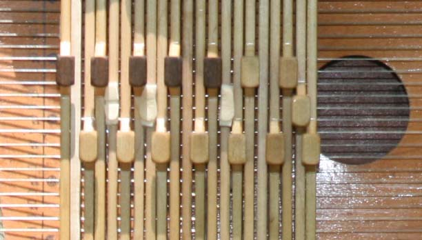 Chord bar close-up with a few middle row half-height buttons added