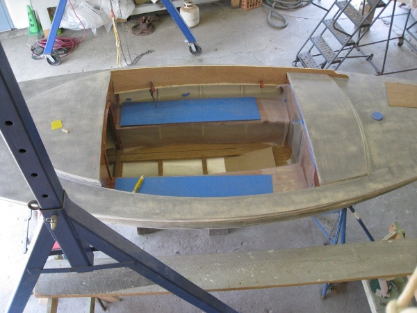 A very comfortable cockpit. The interior woodwork (under protective cover) was completed at Englishman Marine.