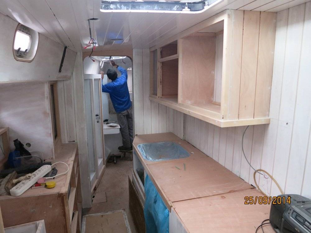In the galley looking forward. There is a large amount of storage with the upper cabinet mounted on the side of the keel case.