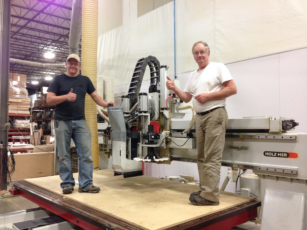 Bill and Shane, two members of the CNC Experts team celebrating after a successful Holz-Her cnc retrofit.