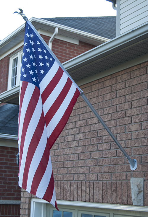 FLY-RIGHT - Fly-Right flagpoles are designed with a unique torsion rod system and swivel rings so the flag never wraps or tangles. Gold Eagle cap and 3 Ft. x 5 Ft. U.S. Flag included. Available in a 12 Ft. Model that installs with a ground mount anchor in 1 minute with no digging and no cement footing.