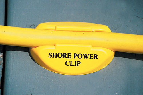 SHORE POWER CLIP - The safe and reliable way to secure electrical shore power cords in high traffic areas. Easy to install and use, the Shore Power Clip is designed to hold a sturdy 30 Amp marine power cord in its' low profile