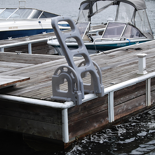 POLYETHYLENE STAND OFF FLIP-UP - Tough and durable, this roto-molded ladder swings up and out of the way, locking in place when not in use. The Stand Off roto-molded ladder extends into the water at a 60 degree angle to make getting out of the water easier. Will not corrode with exposure and will not fade or crack. Molded-in U.V. inhibitors and fungicides.Rail Height: 20-1/2