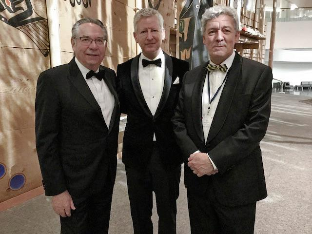 Dockedge+ President Wally Szwez (left) accompanied by Mieke Pynnaert, head of the Economic Mission of Flanders (centre) and Bruno Saverys, CEO of Zingametall (right), at a gala event hosting the Belgian royal family in Ottawa, Ontario