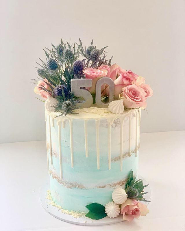 50th Birthday Celebrations for a very special lady. Fresh flowers decorate this beautiful ombre' semi naked cake #50th#pastelcolours#cakeshopconcord.