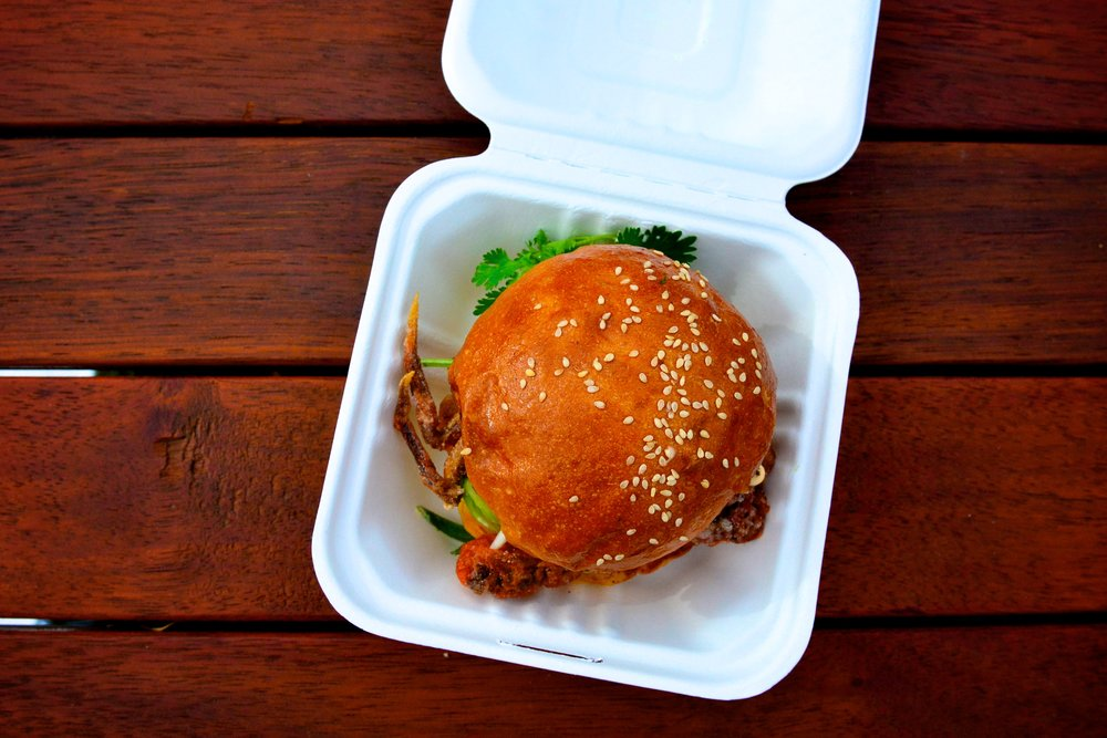 This  almost  defies the tips above but the polystyrene container shows this was a take away meal eaten outside on a wooden table. It was amazing by the way, soft shell crab burger from  Hammer & Tong