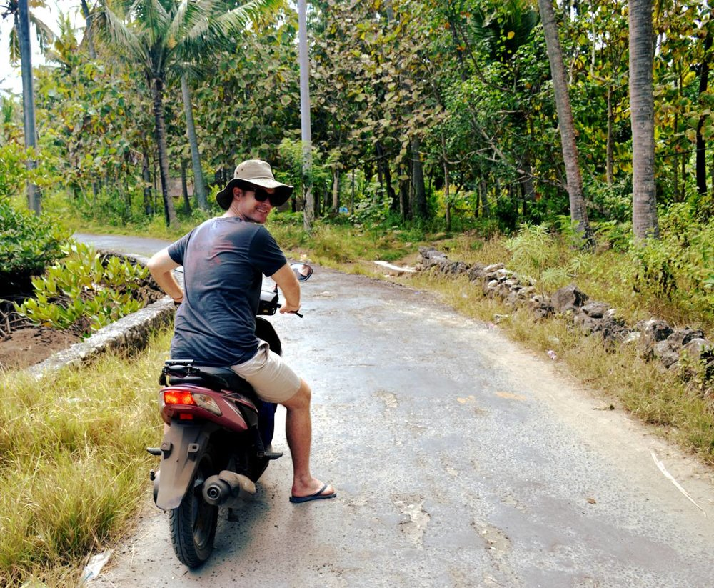 Bali Ubud man driving scooter
