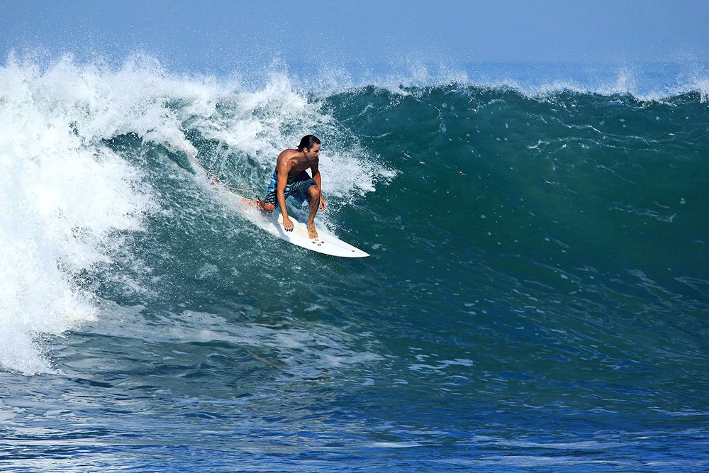 Surfing during group trip in Bali