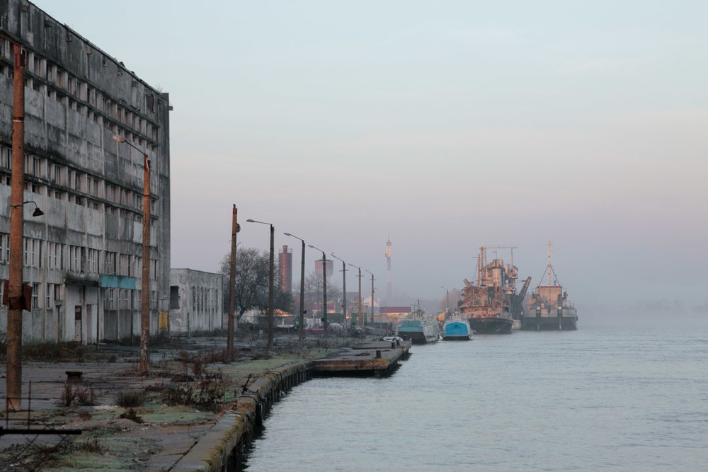 Sulina, Romania,November 2017. The harbour, with an old decayed factory.