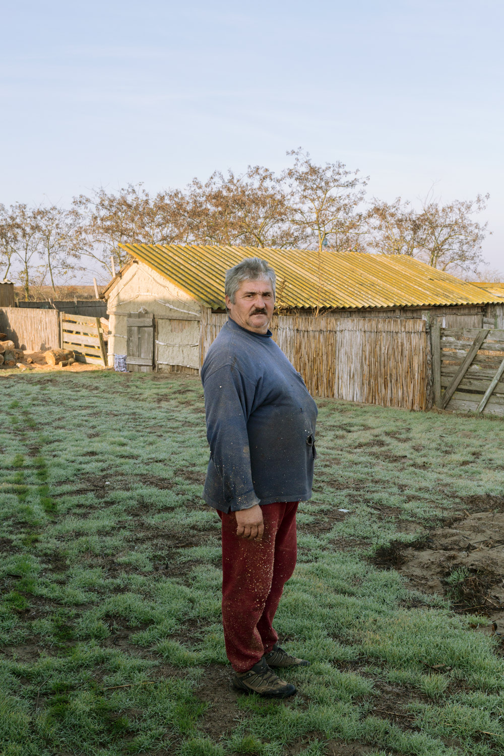 Sulina, Romania, November 2017. Outside of town, a farmer next to his house.