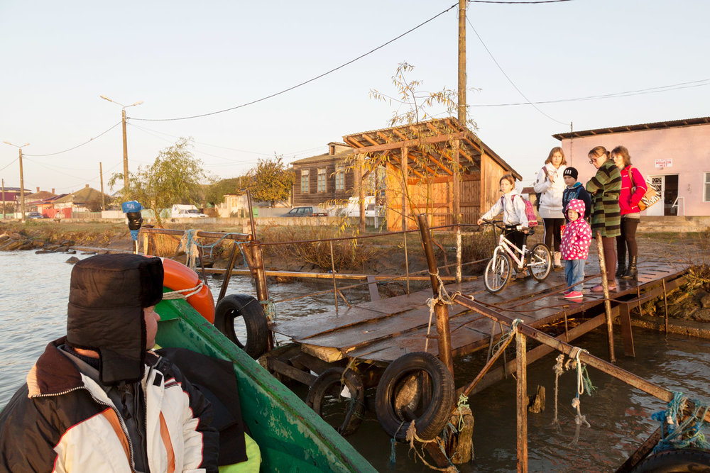 Sulina, Romania,November 2017. People waiting the boat which will let them cross the main channel.