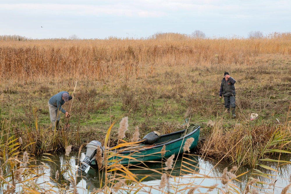 Sulina, Romania, November 2017. Farmers are taking care of the fields, preparing them for the next season. Around Sulina it has plenty of channels, so everyone has a small boat.