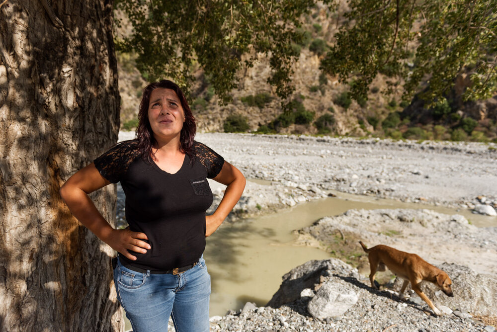 Domenica Romeo (36), shepherd-sentinel of Muccari, watches her herd of goats in the Aspromonte National Park, August 2018.
