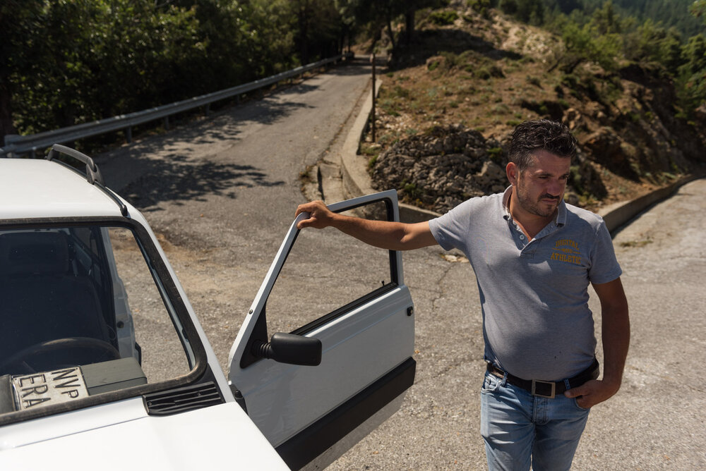 Nino Nucera, shepherd-sentinel of Bova, next to his old Fiat Panda 4x4 used to graze his herd in the Aspromonte National Park, August 2018.