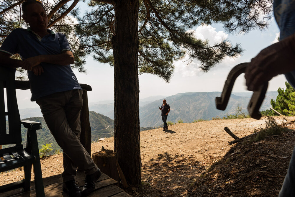 Three employees of Calabria Verde, the forestry public company who handles the woodland heritage, working in a lookout to spot wildfires near Roghudi Vecchio town, August 2018.