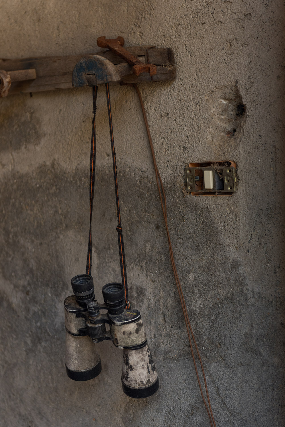 Binoculars on the outside of an abandoned house in Casalinuovo in the Aspromonte National Park, a town inhabited by only two shepherd brothers, August 2018.