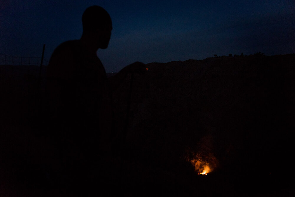 Carmelo, a local shepherd, watches the end of a wildfire that broke out on August 14, 2018 near his pastures around Barone, on the Aspromonte National Park's borders.
