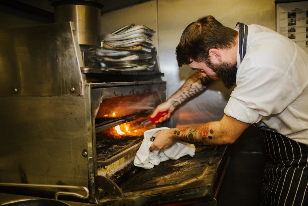 Chef at the Josper oven at The Globe pub and restaurant in Warwick.jpg