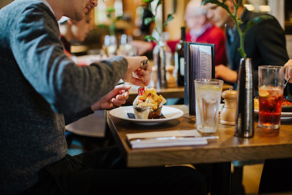 Customer enjoying dinner in the restaurant at The Globe pub and hotel in Warwick.jpg