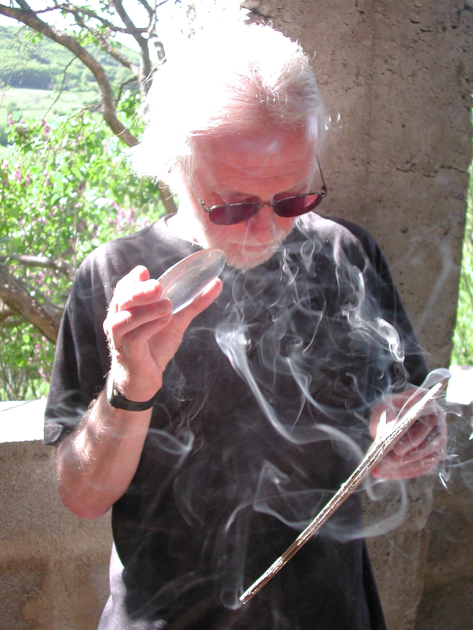 A rare picture of Roger making work by burning with a magnifying glass onto card. Taken in France by Isabella Oulton.