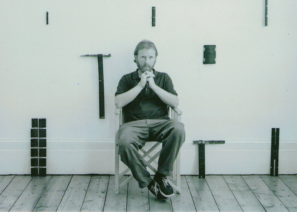 Roger Ackling - 1947-2014 Photo: John Riddy Roger agreed to this exhibition in the year before he died of motor neurone disease. This photograph was used to publicise a book of essays by his former students and colleagues: Roger Ackling: Between the Lines, edited by Emma Kalkhoven.
