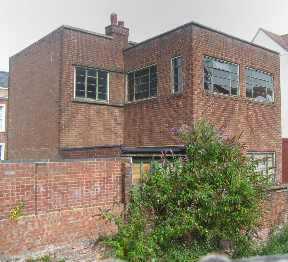 A view of the back of the original building, seen from the Purfleet. A first-floor terrace is being added to the near corner, but otherwise, it is being restored to retain as much as possible of the 1930s design.