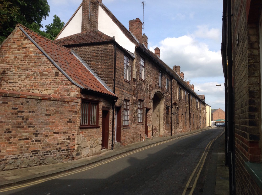 Part of the old priory behind St Margaret's Church, now converted to houses by the King's Lynn Preservation Trust who have been largely responsible for saving the Old Town.