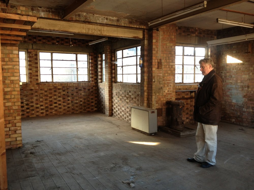 Sandy Heslop contemplating the empty upper floor before construction began.