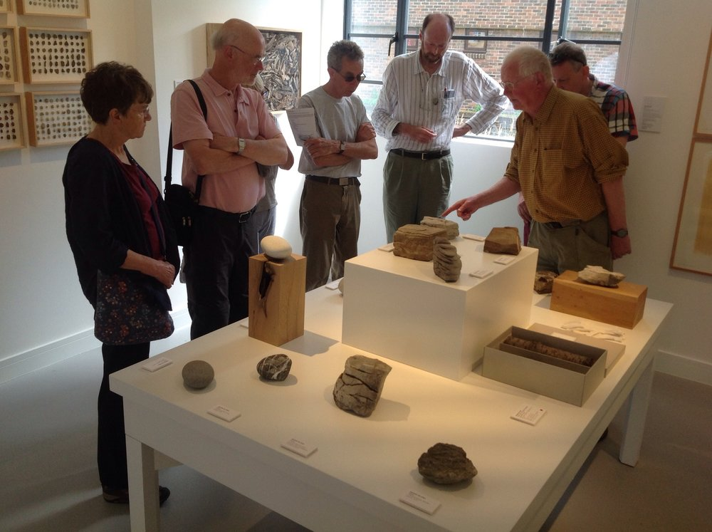 Robin Stevenson and Tim Holt Wilson talking about the stones on display at GroundWork from herman de vries's 3 places of action: Steigerwald, Digne les Bains and Gavdos, Greece.
