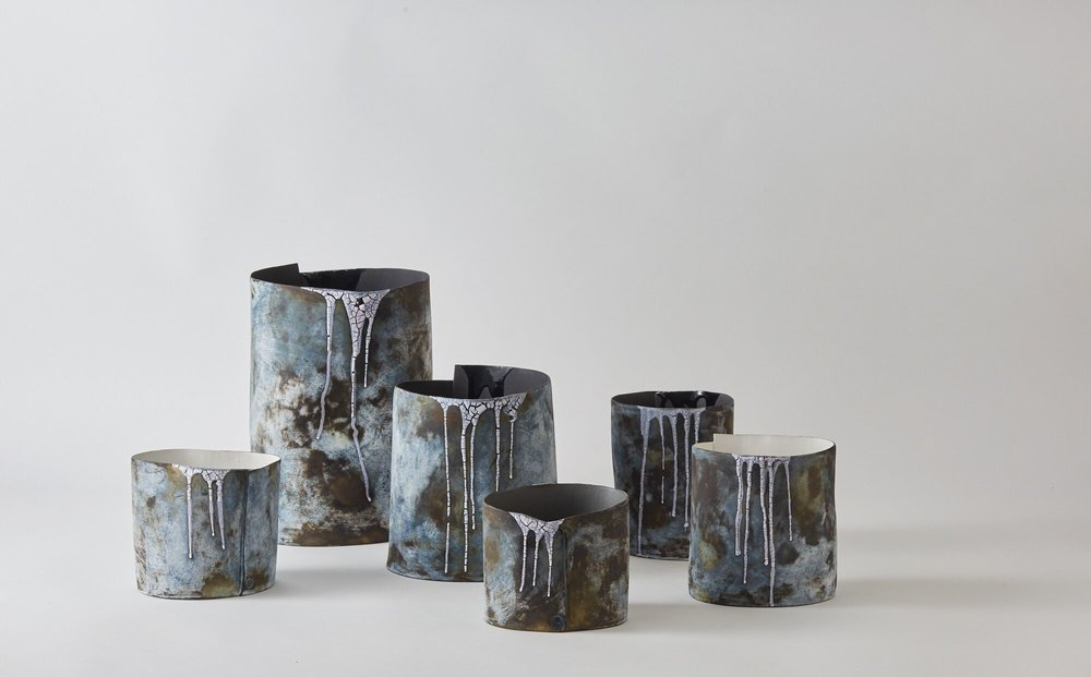 This is part of a collection of stoneware vessels made following the artist's visit to Iceland. It is a perfect medium to reflect her responses to that country's fragile, watery, changing landscapes.