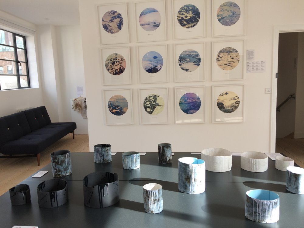 Hilary Mayo's collection of ceramics on show with Gina Glover's Melt series of photographs, showing different reflections on icy landscape and the impact of climate change.