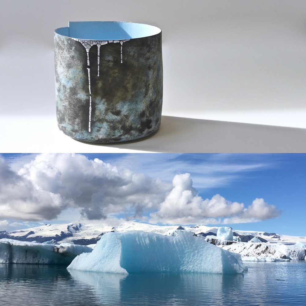 One of Hilary Mayo's dramatic Icelandic landscape photographs next to one of the pots which it inspired.