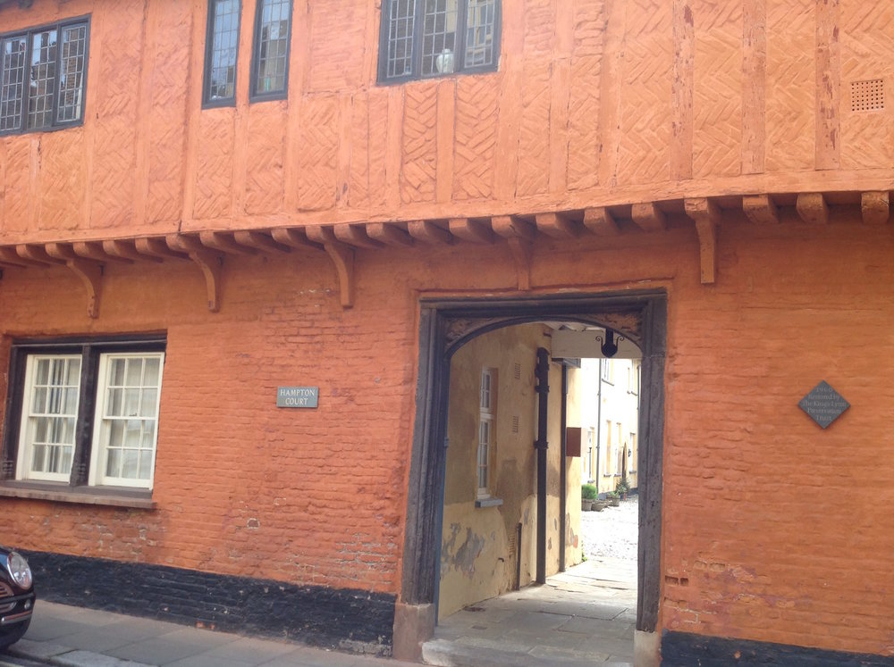 Half-timbered buildings were normally covered over, so Hampton Court and the Valiant Sailor in Nelson Street are more 'authentic' in that the bricks are covered in a rendered surface
