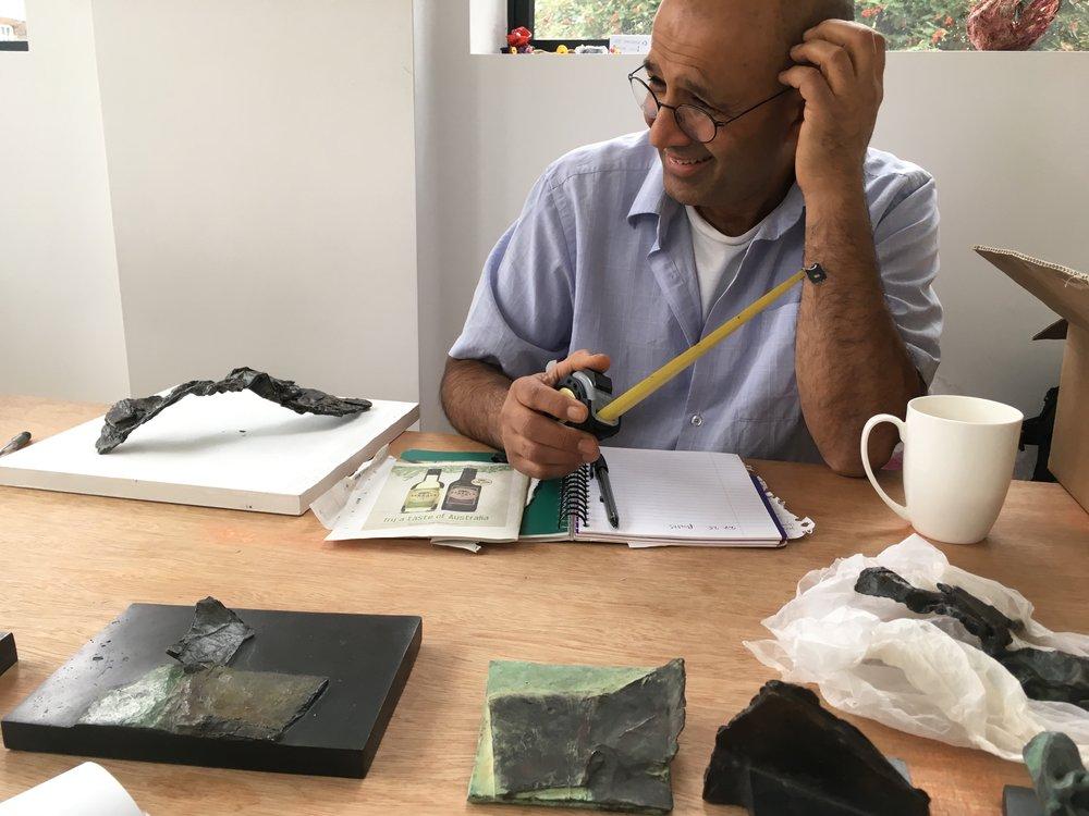 Kabir Hussain planning our exhibit at GroundWork