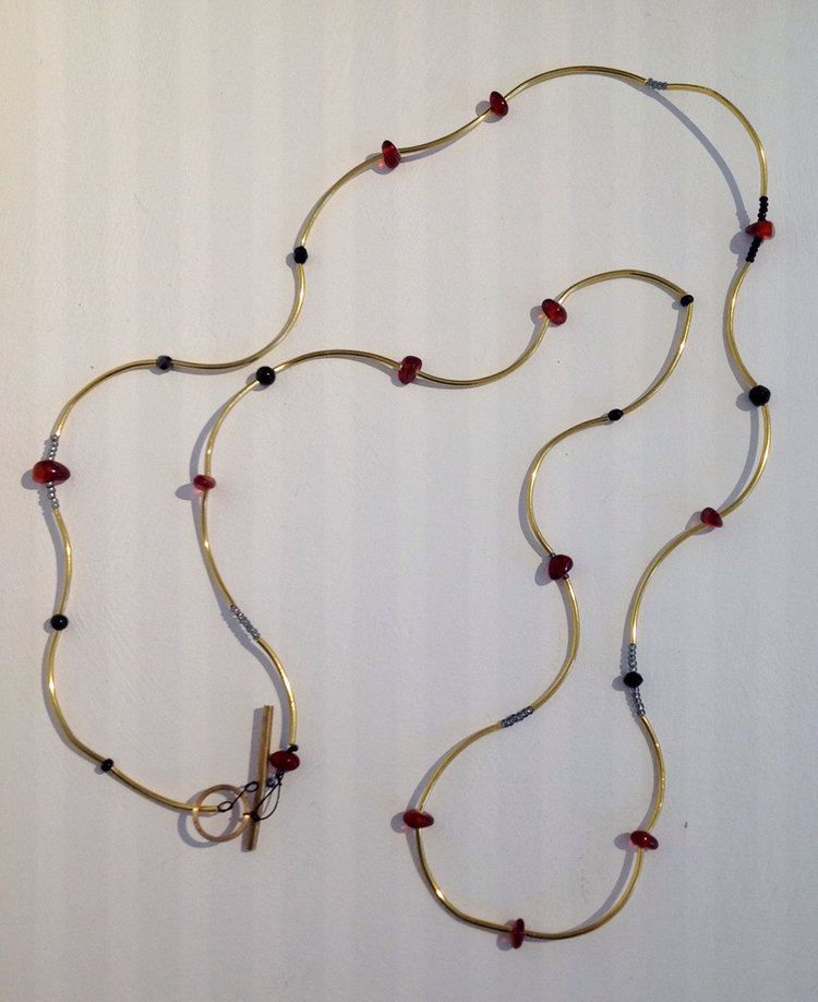 Kirsten Sonne Necklace with curved brass tube, amber and metallic beads