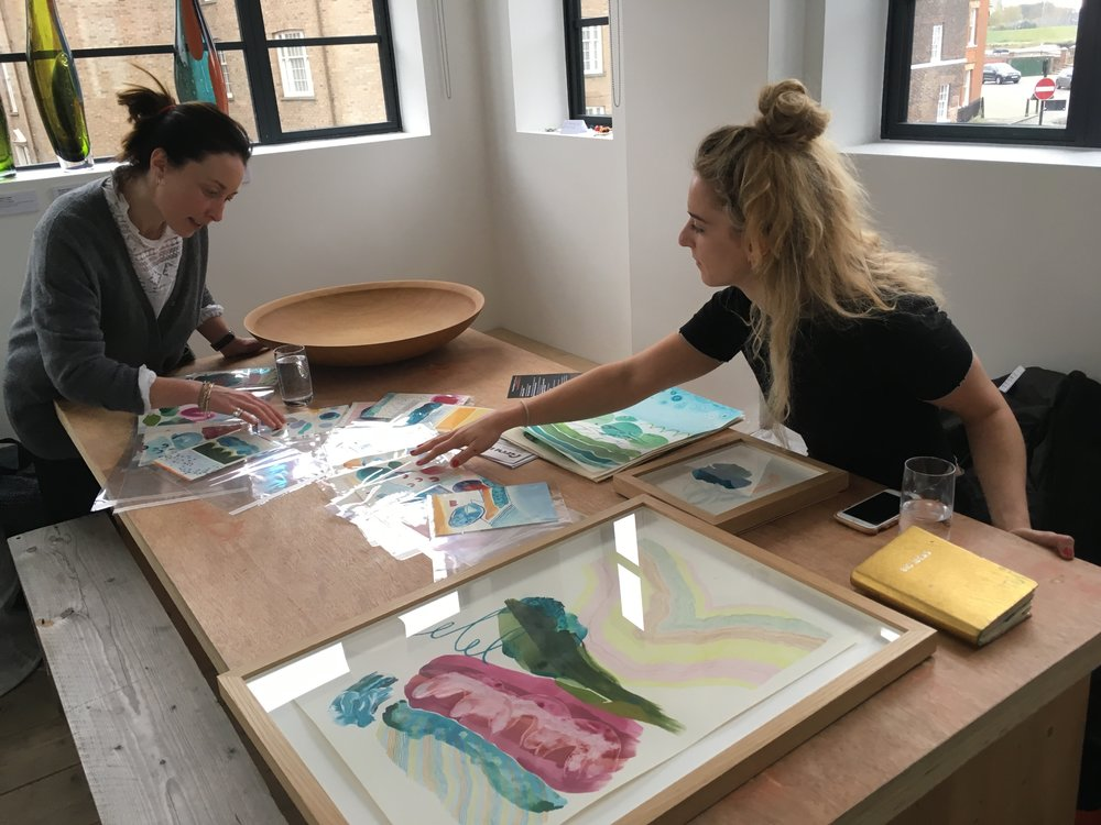 Emma Howell and Amy McGregor selecting work in 2018