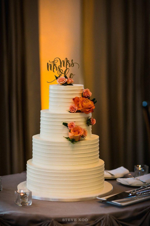 White and Orange Wedding Cake