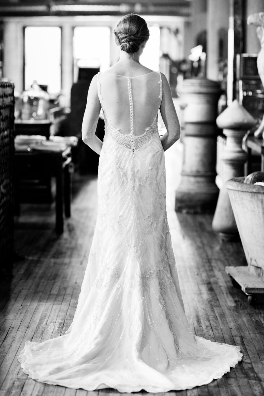 Sheath lace wedding dress with open back  Planning By Wrap It Up Parties  Artifact Events