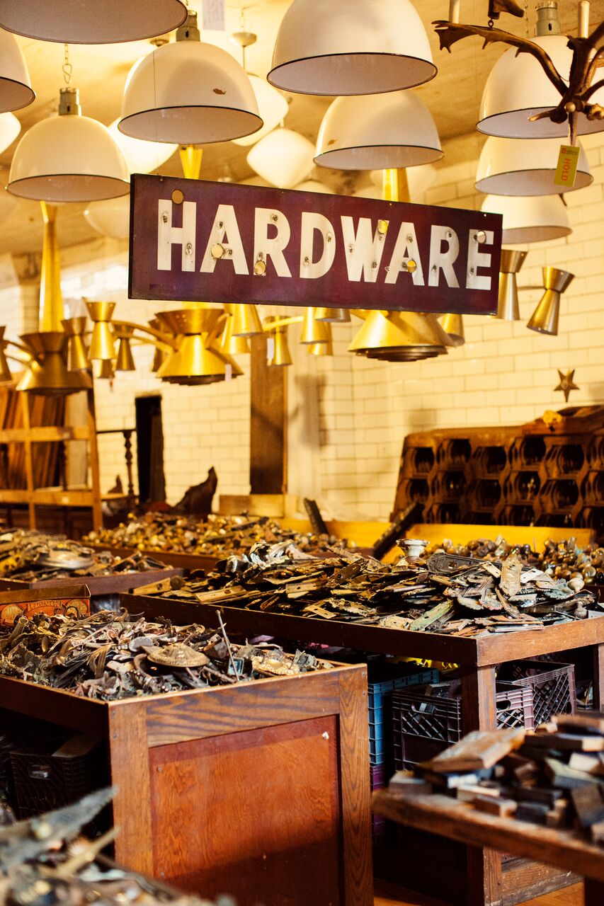 old hardware sign and lampshades   Planning By Wrap It Up Parties  Artifact Events