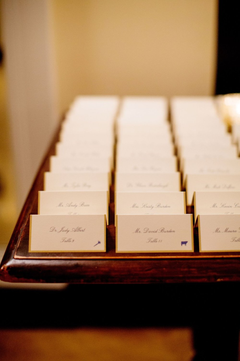 Classic white and blue escort cards   Handwritten Escort Cards   Wrap It Up Parties