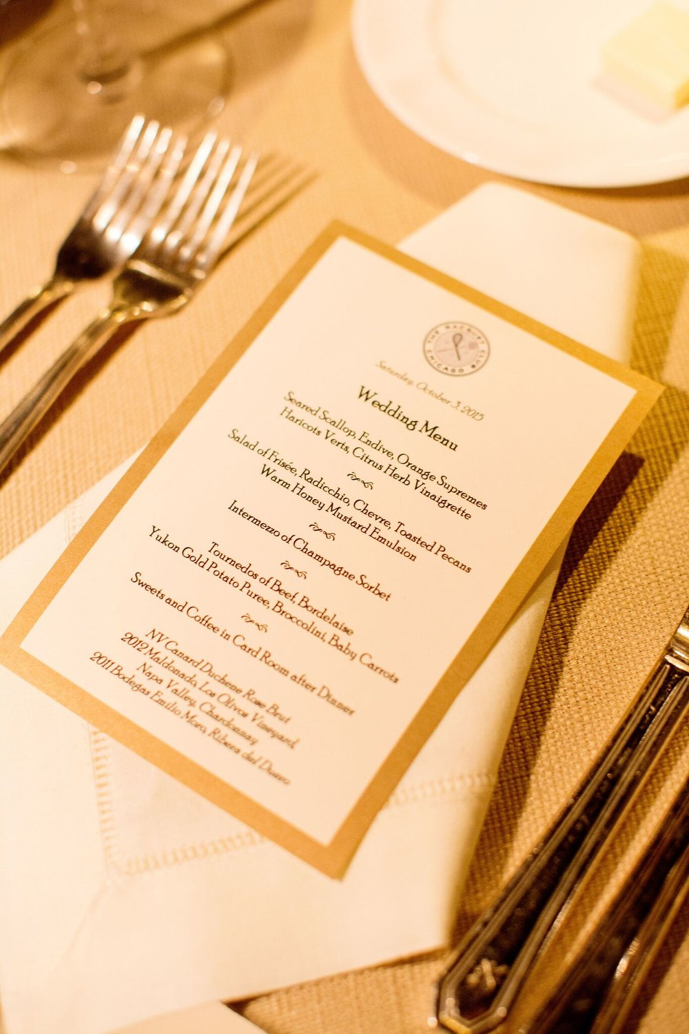 Traditional gold menu card at place setting  Planning By Wrap It Up Parties