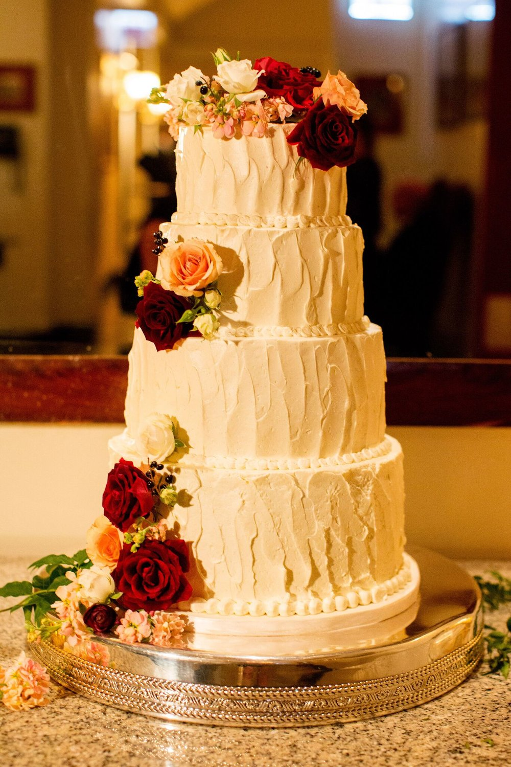 Traditional white buttercream cake with floral details   Planning By Wrap It Up Parties