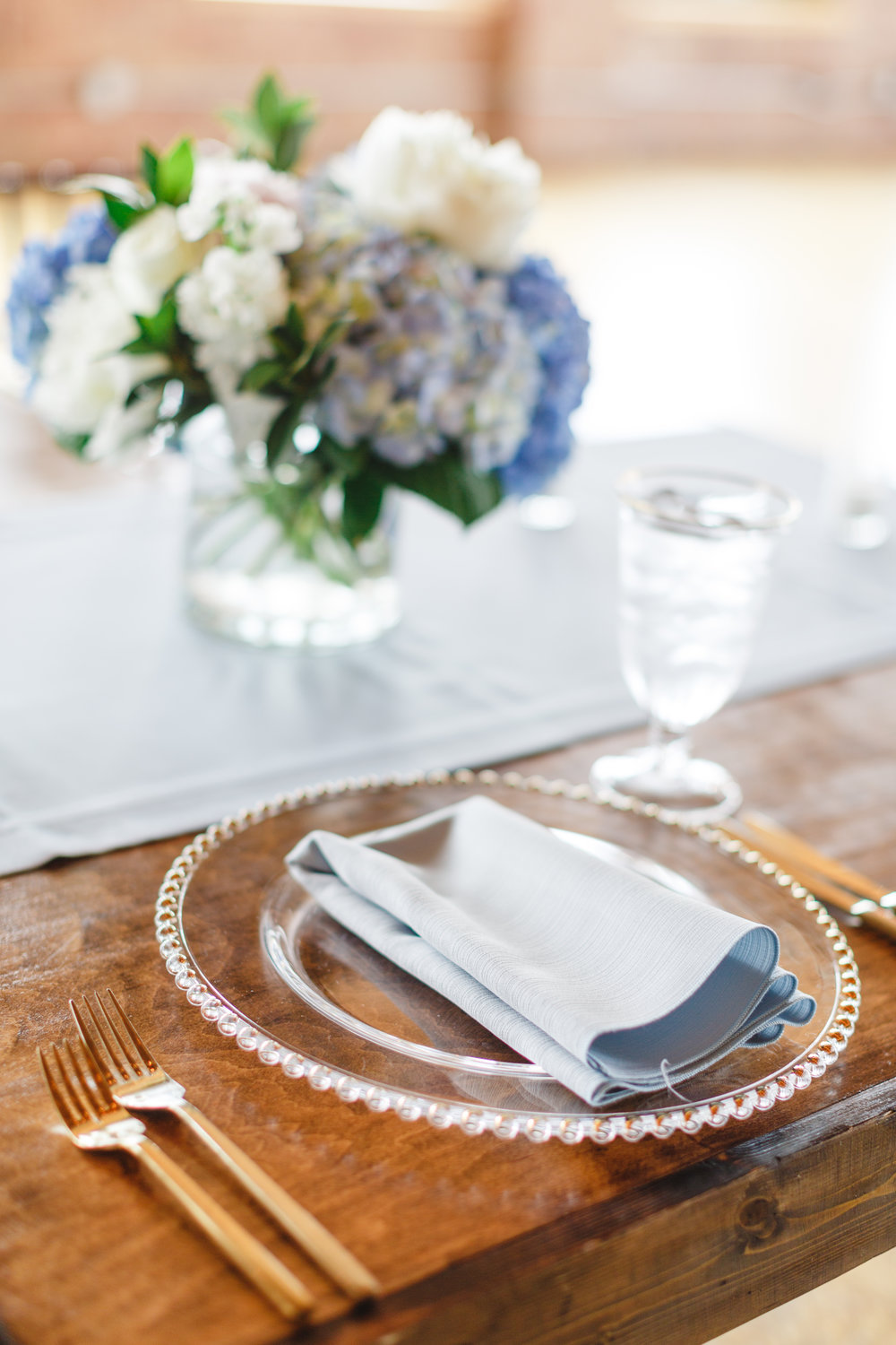 Clear Chargers and Light Blue Linens