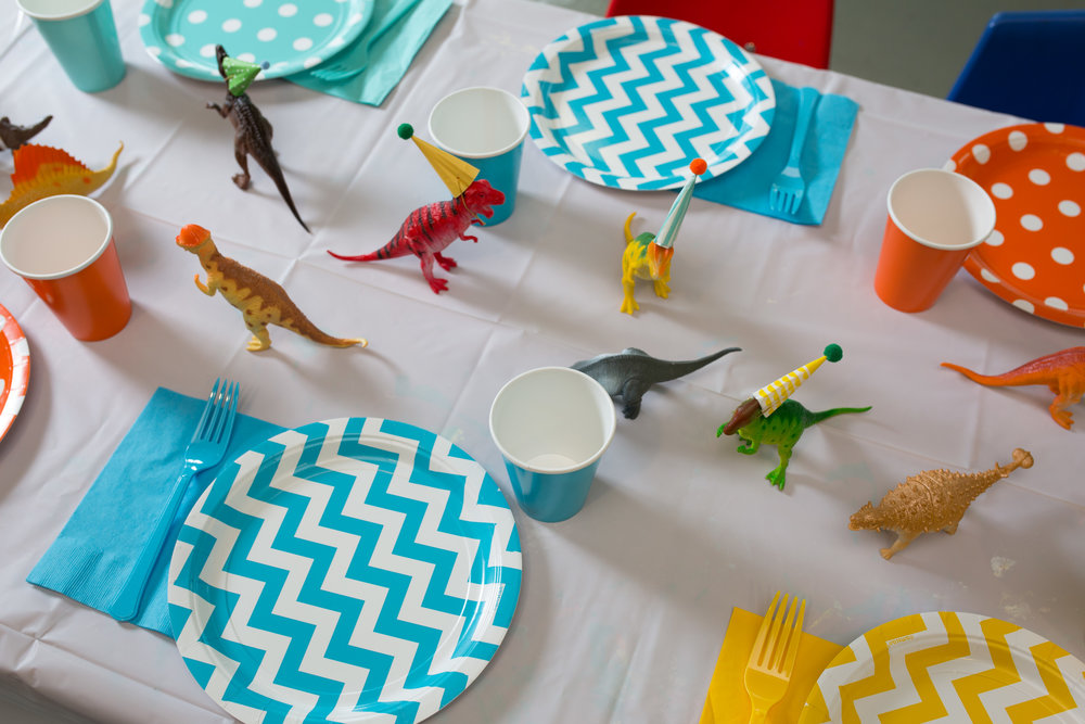 dinosaur first birthday, dinosaur party details, dinosaur table, Wrap It Up Parties