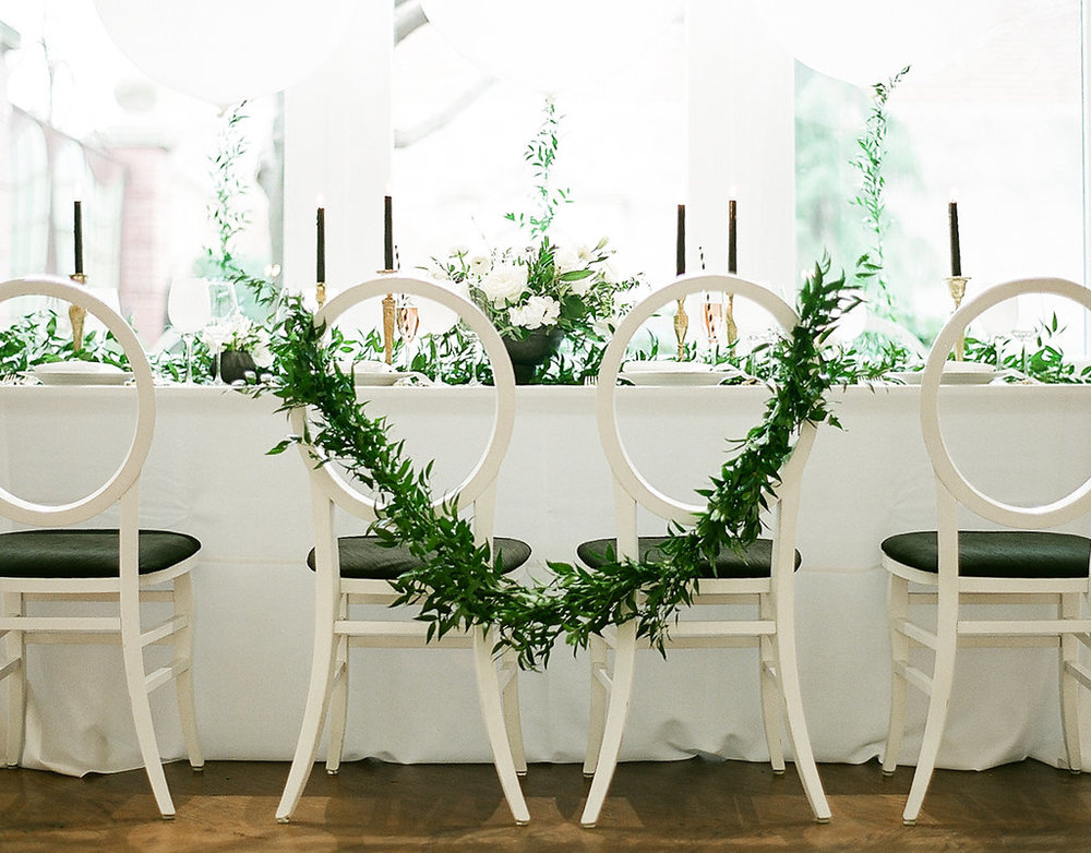 Greenery Filled Shower  Tapered Candles   Green Chair Accents  Planning by Wrap It Up Parties