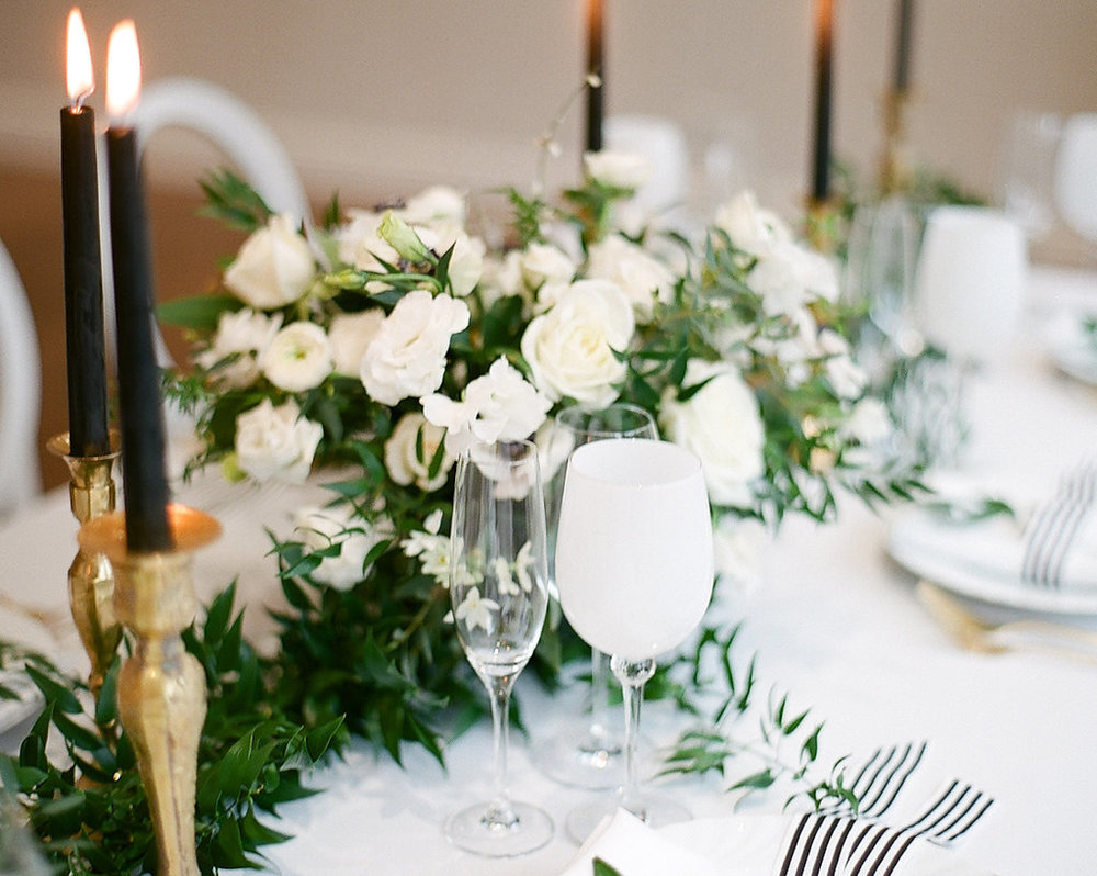 Green and White Centerpiece  Black and Gold Taper Candles  Planning by Wrap It Up Parties